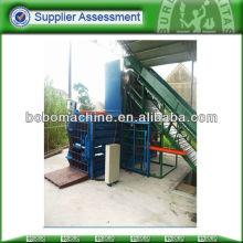 Máquina de empacotamento horizontal manual para resíduos de papel