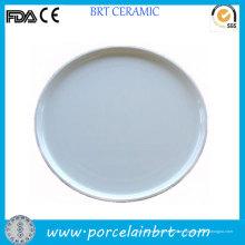 Tarta redonda de porcelana y bandeja de té