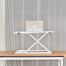 Sit-stand mini laptop desk on bed adjustable.