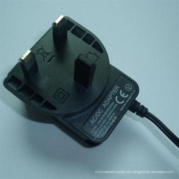 UK Wall Plug-in 5V 9V 12V 24V 0.25A 0.5A 1A Adaptador de corriente AC / DC