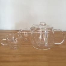 Набор прозрачных стеклянных чайников и чайных чашек