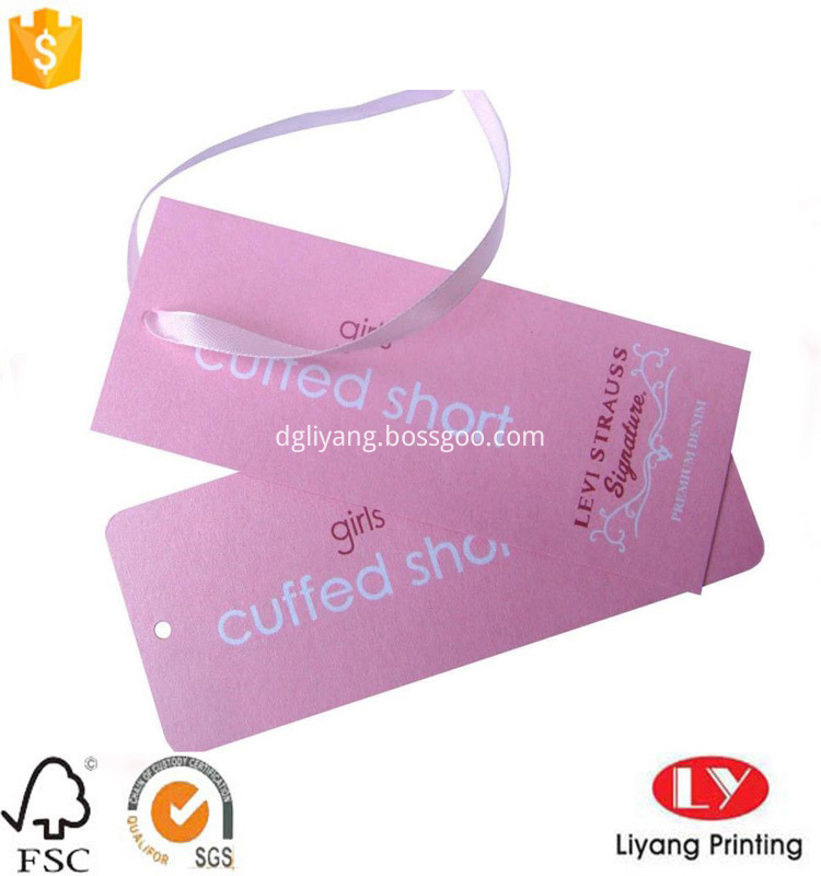 Paper hang tag with ribbon on top