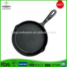 Plaque de cuisson ronde en fonte pré-assaisonnée