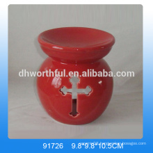 Red ceramic incense burner with hallow-out design in cross shape