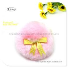 Sopro de pó solto rosa com borboleta de fita