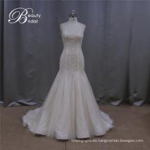 Rebordeando un vestidos de Novia de línea romántica