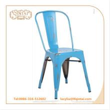 Schälen des blauen Weinlesemetallstuhls kupferne Farben-Loftstuhl