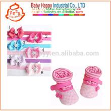 China atacado cosméticos sapatos de algodão bebê com linda flor headwear