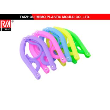 Molde de suspensión de ropa plástica plegable de viaje colorido