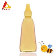 Miel de abeja pura acacia en la cara