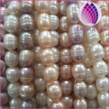 Wholesale natural freshwater rice pearl 10-11mm with screw white peach mauve loose pearl for jewelry necklace