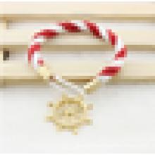 Pulsera de oro colorido de las mujeres del algodón del ancla en la acción