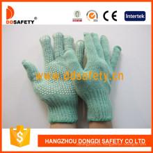 Los guantes hechos punto poliéster verde con PVC blanco puntean un lado Dkp139
