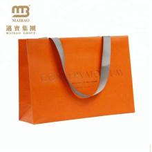 Kundenspezifische große orange Papiergeschenk-Taschen mit Griffen