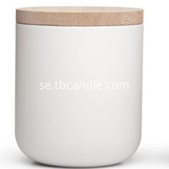 white ceramic vessel with wooden lid for soy candles