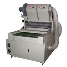 Machine à épandage à la poudre à chaud