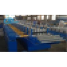 Máquina formadora de rollo de barrera portadora