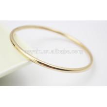 Diseño de la pulsera del brazalete del oro simple redondo redondo