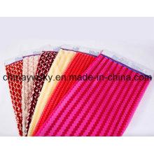 El paño grueso y suave del poliéster PV cepilló la tela de la felpa de la felpa del picovoltio para la ropa, cama de Minion de la felpa