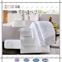 Proveedor de Oro Alibaba blanco barato toallas de spa toalla de baño del hotel en Guangzhou
