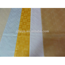 Tela africana de la ropa y brocado bazin 100% de algodón de la tela para el vestido de la señora feitex China