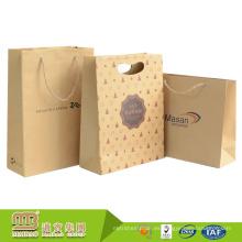 Diseño de encargo del logotipo Brown Hole Patch Hole Die Cut Handle Bolsa de papel biodegradable de Kraft con precio competitivo