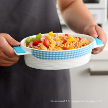 ceramic bakeware with heat-resistant silicone handle grips and non-slip silicone base