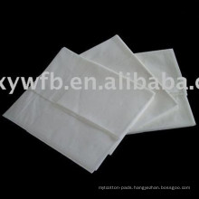 Disposable nonwoven towel for bath