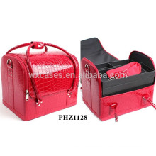 red crocodile bag with 4 removable trays inside and one shoulder strap