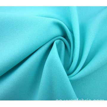 Partihandel vävt Plain Dyed Blue Stretch Fabric Garment