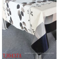 Nuevo diseño LFGB PVC imprimió el mantel del modelo con el respaldo Spunlace