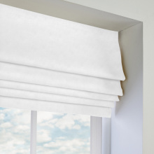 white fabric roman blinds
