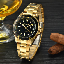 Mens business watch with gold steel strap
