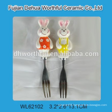 Kitchen butter fork with ceramic rabbit handle
