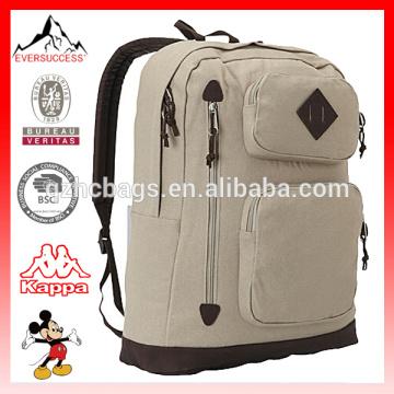 Ordinateur portable élégant d'école et sac à dos de livre pour des étudiants unisexes