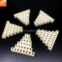Piezas de porcelana para banda calentadora de cerámica porosa.
