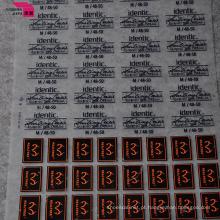 As etiquetas da impressão de transferência térmica para a roupa do esporte decoram a roupa