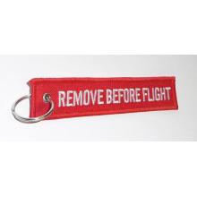 Entfernen Sie vor dem Flug Schlüsselbund Custom Design Stickerei Schlüsselbund
