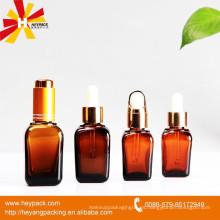 Botella de aceite esencial de vidrio cuadrado de ámbar