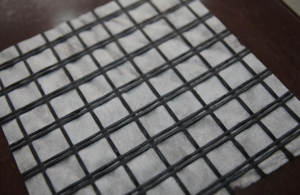 डामर सुदृढीकरण Glassfiber Geogrid Geocomposite