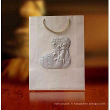 Sacs-cadeaux en papier avec gaufrage spécial