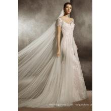 Ilusión escote Champagne ajuste y llamarada vestido de novia