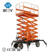 Cuatro ruedas conducen la plataforma de elevación de las tijeras móviles con la batería