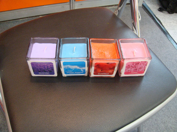 Scented candles with containers