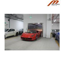 Elevador do carro da porta oposta para a garagem de estacionamento subterrânea