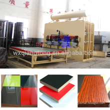 Wuxi Qiangtong automática de ciclo corto melamina MDF laminado línea de prensa caliente