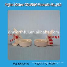 Sostenedor de vela de cerámica a granel al por mayor en forma del reno de la Navidad