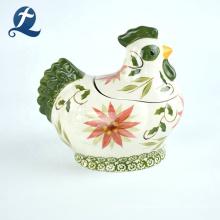 Banco de monedas de cerámica de encargo de la decoración casera de la forma linda vendedora caliente del gallo
