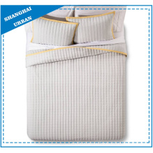 Cream Solid Yellow Border Polyester Quilt Set