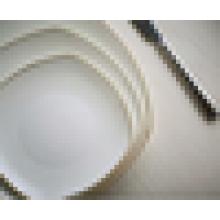 white ceramic hotel dinner plate